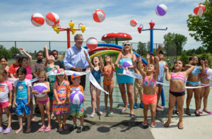 OTTAWA, ONT.: JULY 12, 2016 -- Ottawa Mayor Jim Watson and Gloucester-Southgate Ward Councillor Diane Deans cutting the ribbon at the official opening of the new Splash Pad at Calzavara Park at 1602 Blohm Drive in Ottawa, Ontario, July 12, 2016. The afternoon of fun included music, games, and activities for youth. Photo by Garth Gullekson